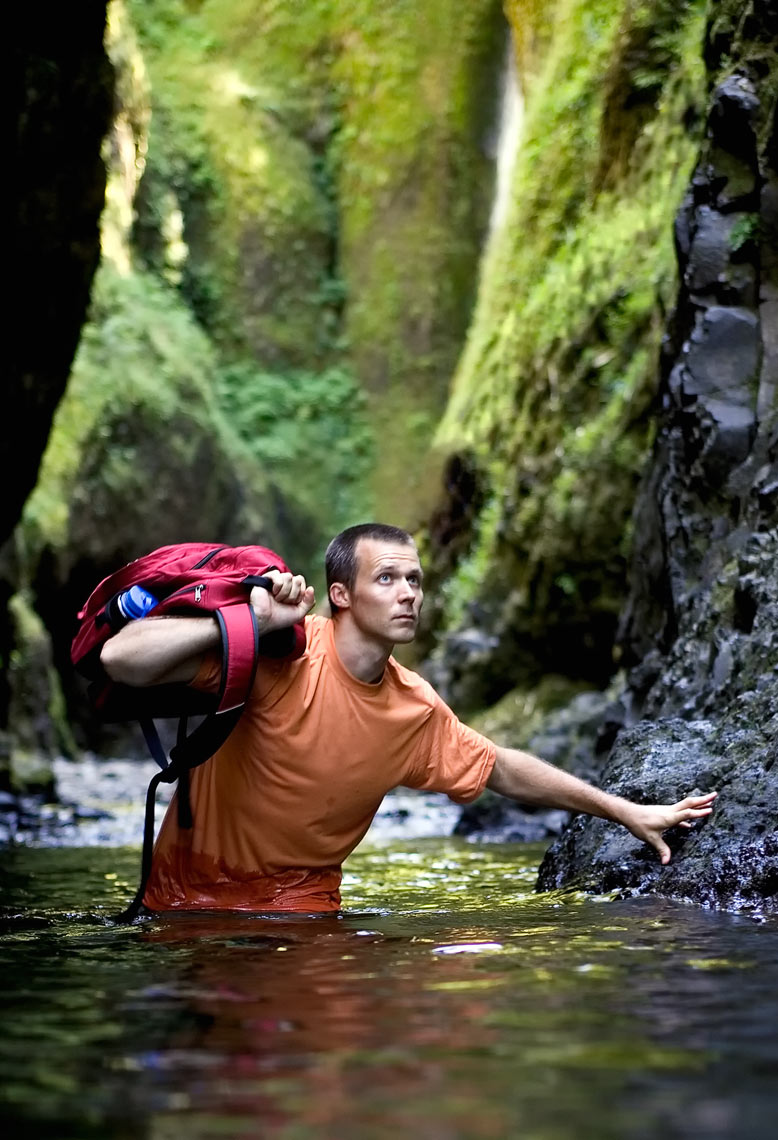 Advertising photography Portland - man walking through water in a gorge
