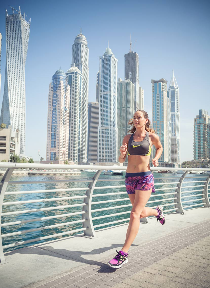Commercial photography Portland - woman running at the Dubai marina