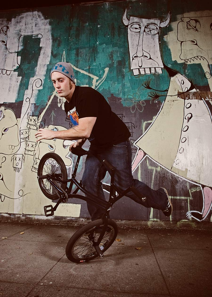 Commercial photography Portland - free riding at night in front of wall mural
