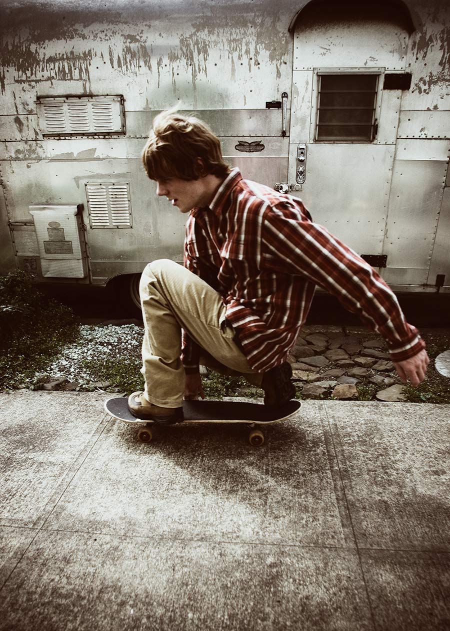 Commercial photographer Portland - model skateboarding by Airstream trailer