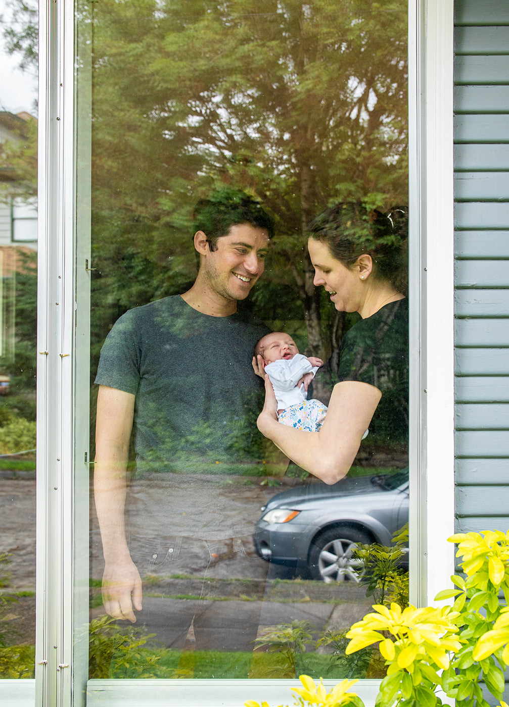 Portland Editorial image of healthcare worker, husband and newborn