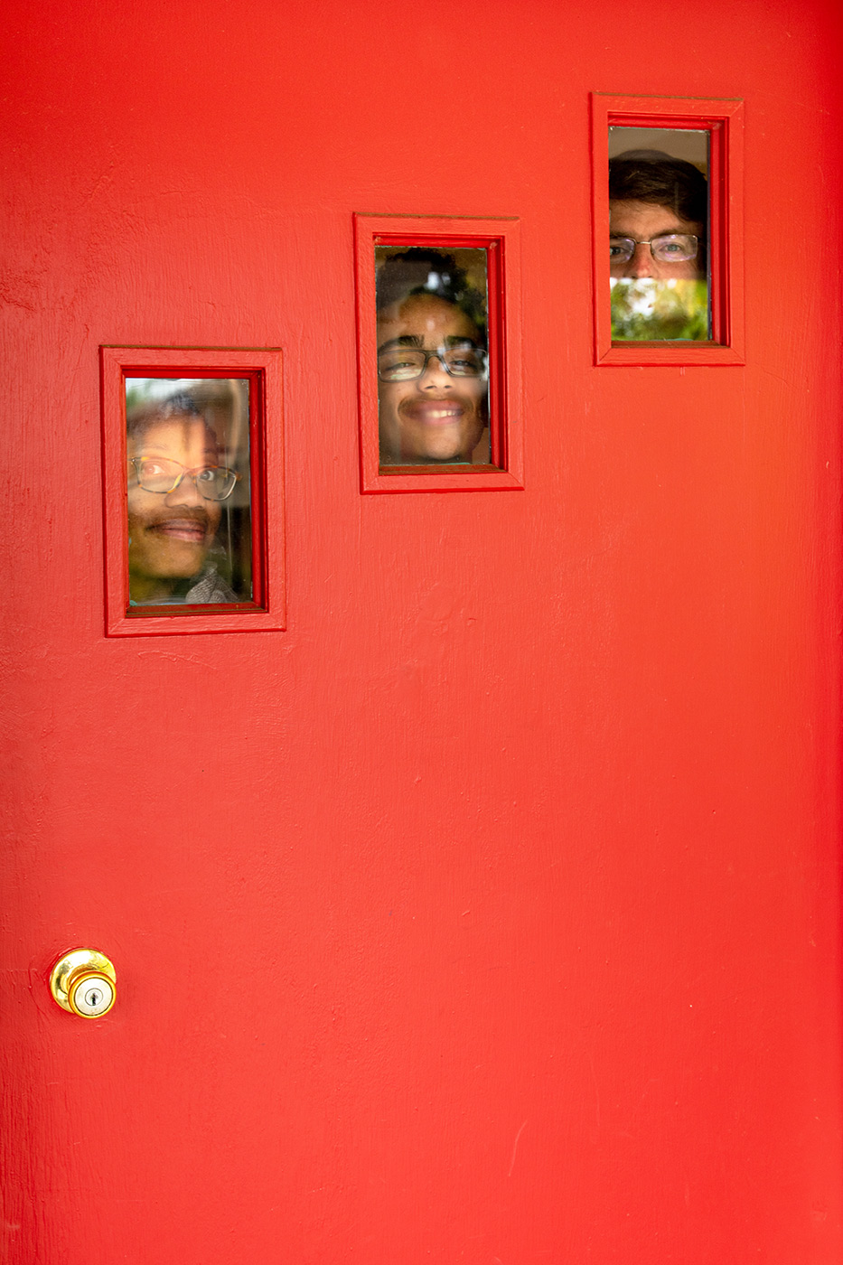 Portrait of family at their door in Portland
