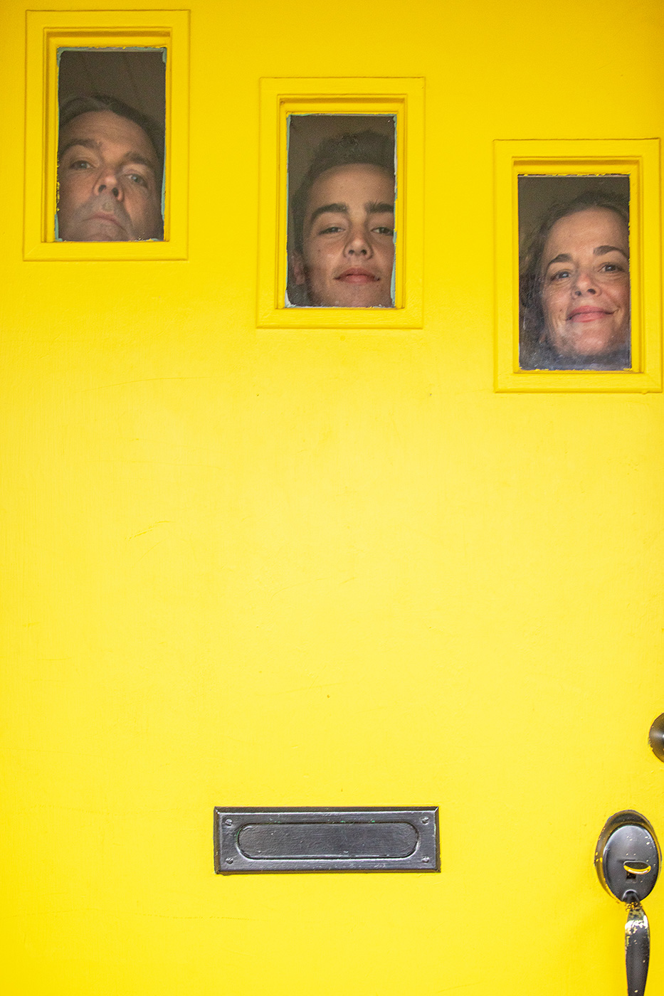 Editorial portrait of family at their front door