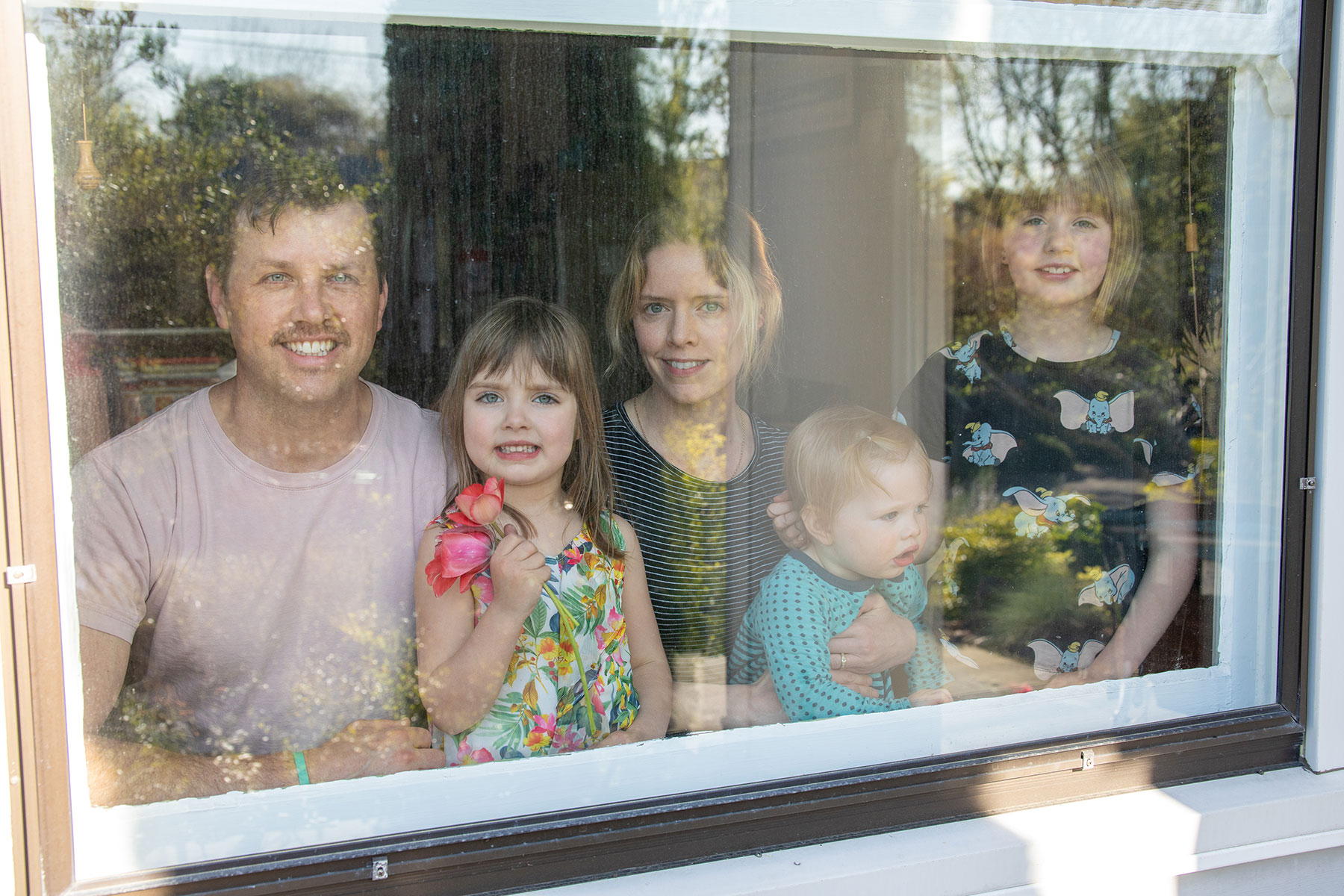 Portrait of family at their window in Portland