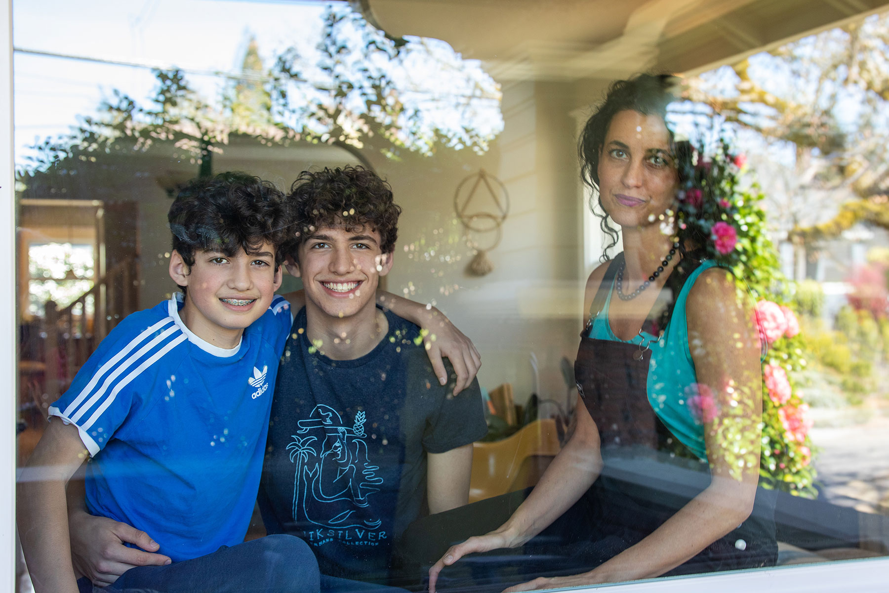 Editorial portrait of a mom and her two boys at their window