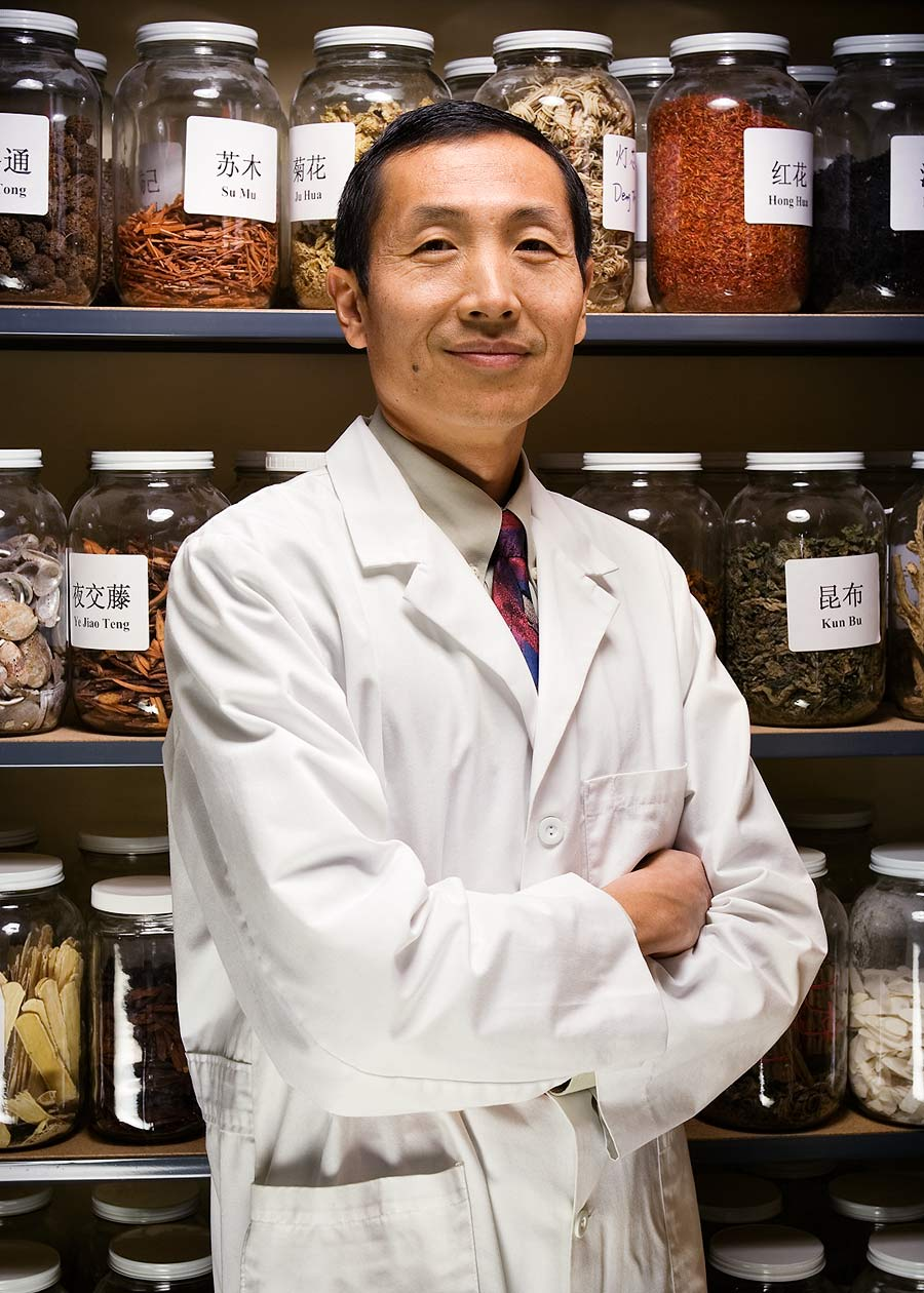 Commercial photographer Portland - doctor in front of Chinese medical herbs