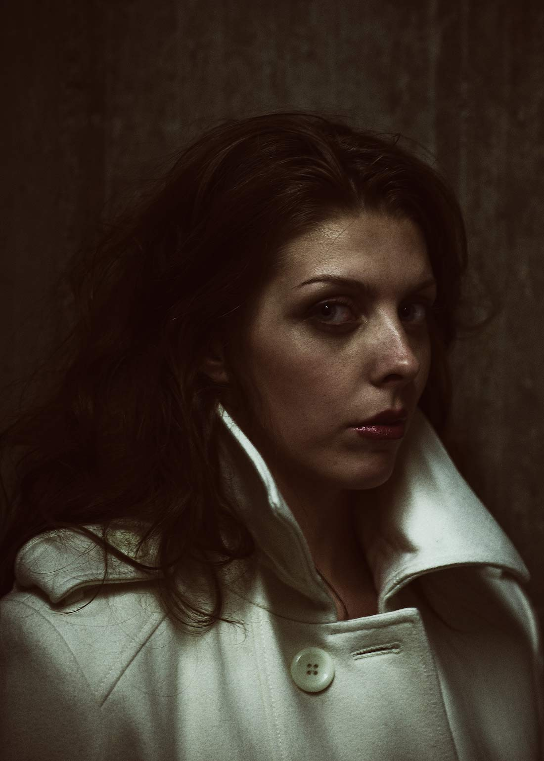 Portland commercial photography - dark portrait of woman in white coat