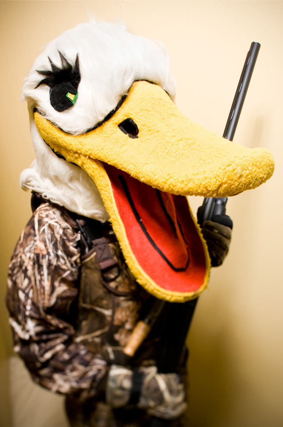 Duck holding a shotgun