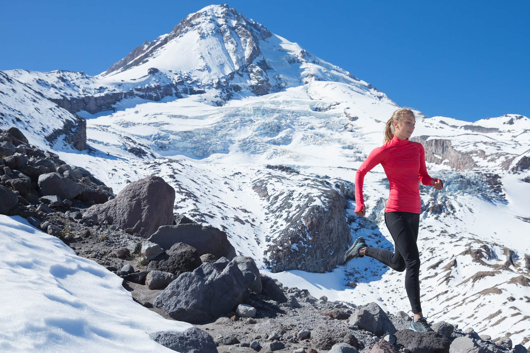 Commercial  photographer Oregon - Woman running on ridge of Mount Hood