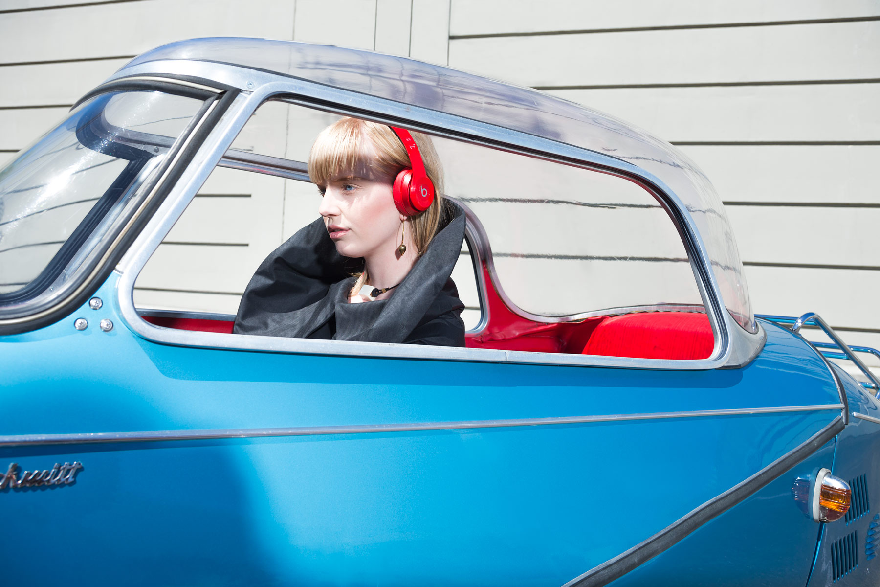 Conceptual portrait of a woman in a Messerschmitt car by Michael Schmitt