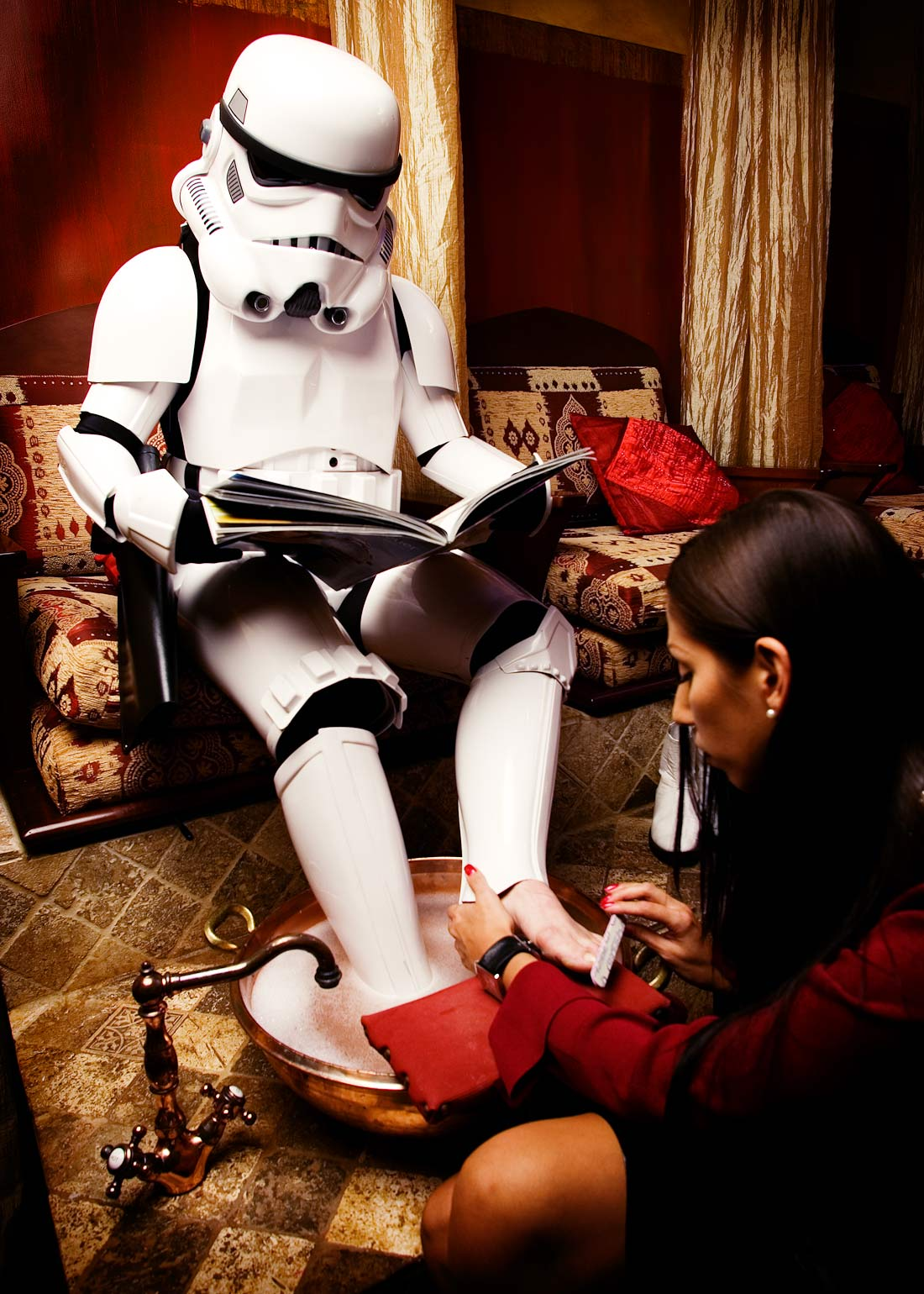 Commercial photographer Portland - Stormtrooper getting a pedicure by a woman in a salon by Michael Schmitt