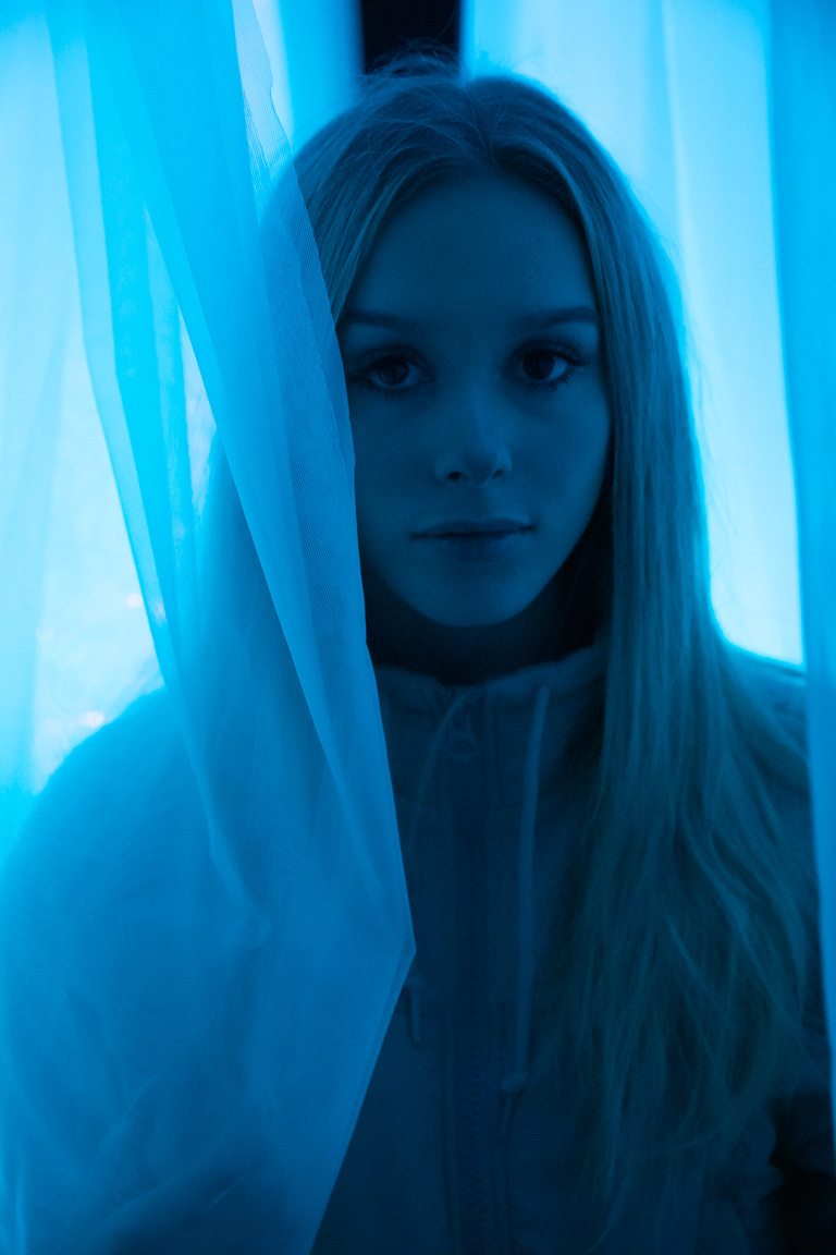 Conceptual photography in Portland - woman surrounded by blue light