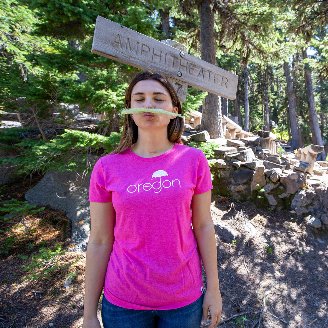 Commercial photography Portland - woman with pink shirt in the mountains