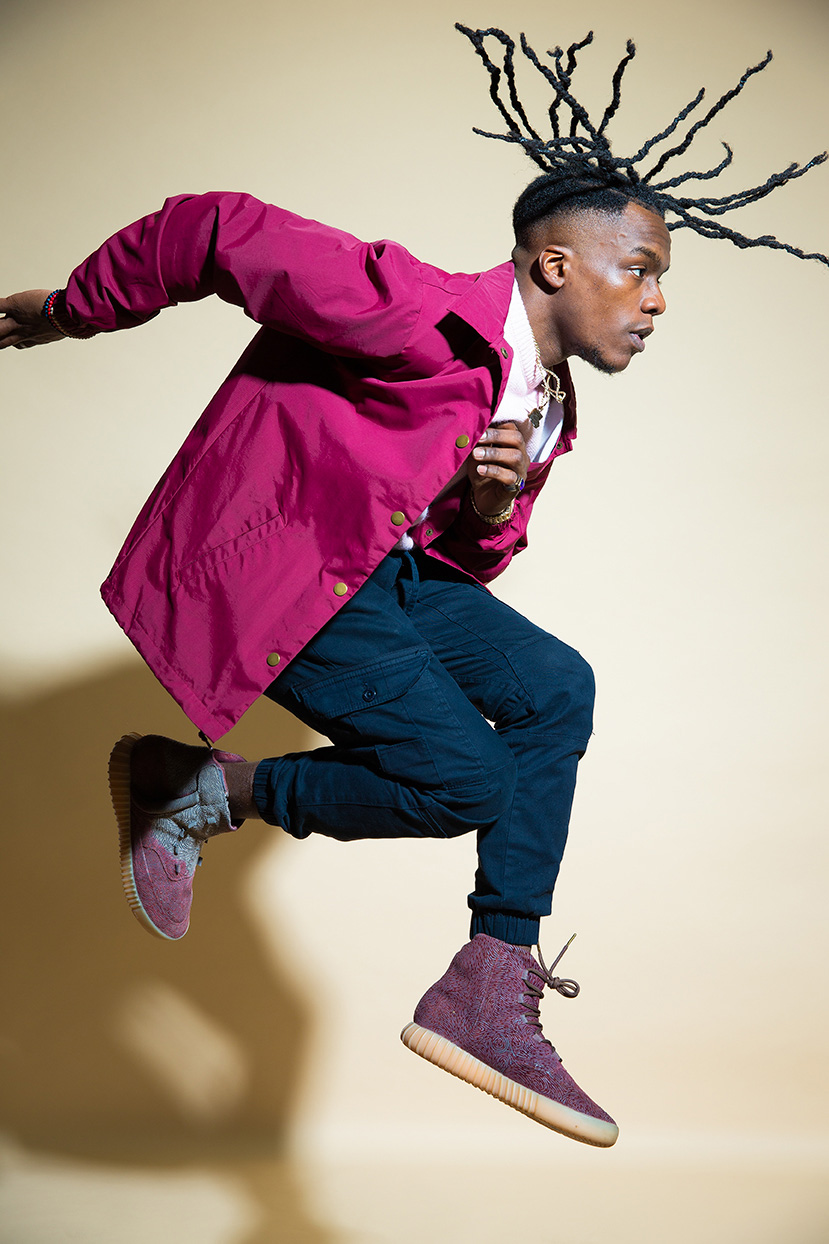 Advertising photographer Portland - man with dreads jumping in the air